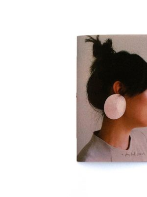Earrings Book. Paper earrings, photography and design by Anna Gleesson. Model: Jenny Soo Yeon Lee.