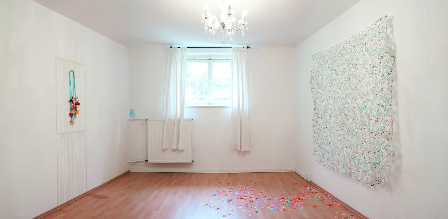 Shari Pierce. He Loves Me He Loves Me Not (Installation), 2013, Bed Sheet (object), Necklace-Mandarin Peels, Honey (Frame on Necklace), Fabric from bed sheet.